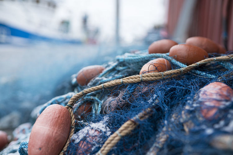 Close-up of fishing net at harbor