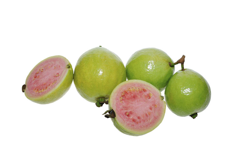 guava fruits isolated on white Fruit White Background Studio Shot Healthy Eating Wellbeing Food And Drink Food Freshness Still Life Green Color Indoors  Cut Out Close-up No People Apple - Fruit Group Of Objects Red Apple Granny Smith Apple Ripe