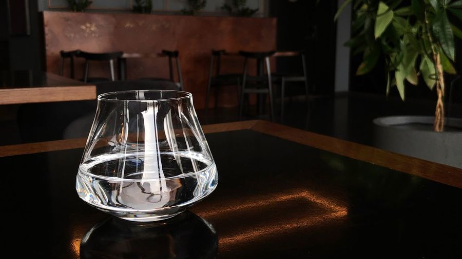Glass with still water on dark table Water Background Still Water Restaurant Water Copy Space Drinking Glass Reflection No People Table Glass - Material Indoors  Glass Transparent Water Close-up Still Life Household Equipment Lighting Equipment Drinking Glass Luxury