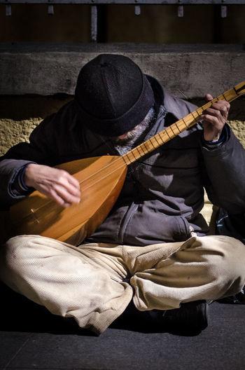 Street musician playing baglama