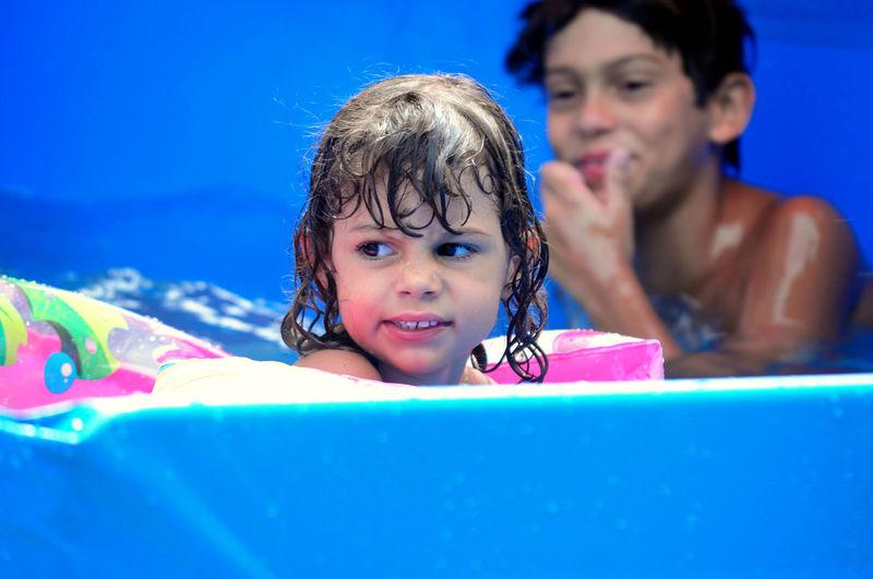 Girl Looking Away In Wading Pool