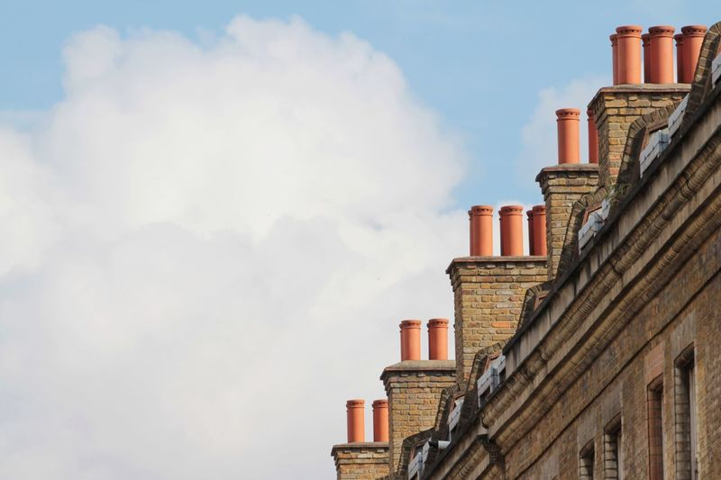 Architecture Building Exterior Built Structure Low Angle View Day Sky Outdoors No People Chimney Chimneys Repetition Cloud Cloud - Sky Bricks Roof Rooftop Clouds And Sky EyeEm Best Shots Urban Geometry In Line Brick Lane in London , United Kingdom MISSIONS: The Architect - 2017 EyeEm Awards The Street Photographer - 2017 EyeEm Awards EyeEm LOST IN London Postcode Postcards The Architect - 2018 EyeEm Awards Capture Tomorrow