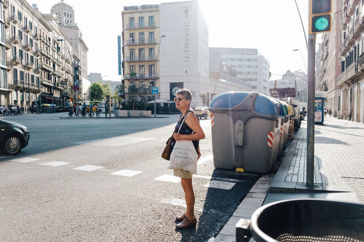 Waiting under the heat | Architecture Barcelona Building Exterior Casual Clothing City City Life City Street Close-up Day Fuji X-T1 Lifestyles Light Outdoors People Road Street Street Photography Streetphotography Sun Waiting Walking Around