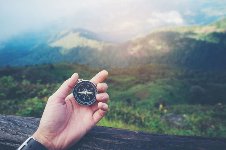 Beauty In Nature Close-up Day Focus On Foreground Holding Human Body Part Human Hand Mountain Nature One Person Outdoors People Real People Scenics Sky Time Watch Wristwatch