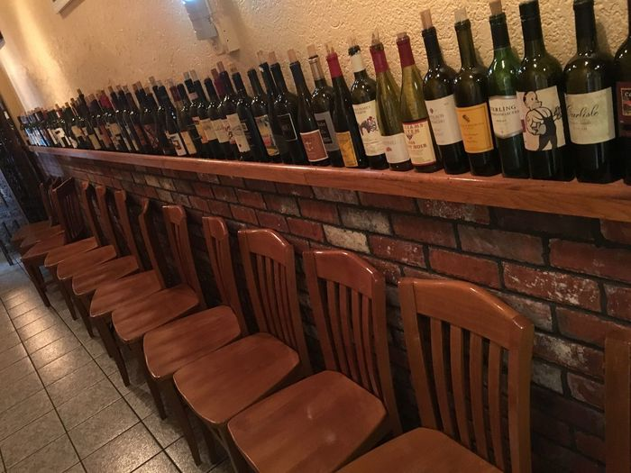 Chairs And Bottles Alone Bottle Chair Cristal Glass Glass - Material Wine Wine Bottles With Out People Alone Things I Like Wood Wood - Material Wall Art Art Gallery Creativity Creative Taking Photos Stone Wall Drinking Drinks Restaurant Diner Vino Solo