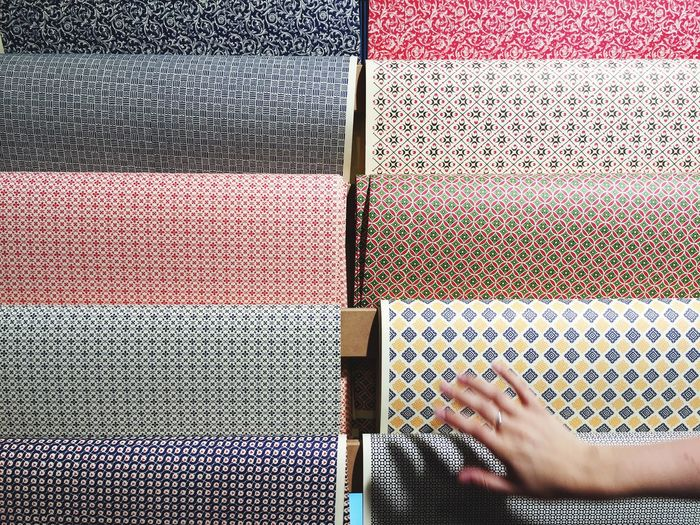 Cropped image of person choosing multi color wrapping papers
