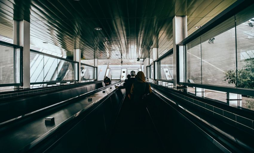 High angle view of people on escalator indoor