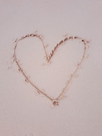 Directly above shot of heart shape on sand