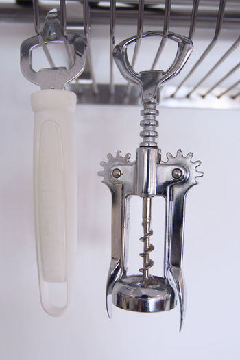 Bottle Opener Close-up Corkscrew Day Equipment Faucet Focus On Foreground Glass - Material Hanging Household Equipment Hygiene Indoors  Metal No People Silver Colored Steel Still Life Transparent Wall - Building Feature White Color