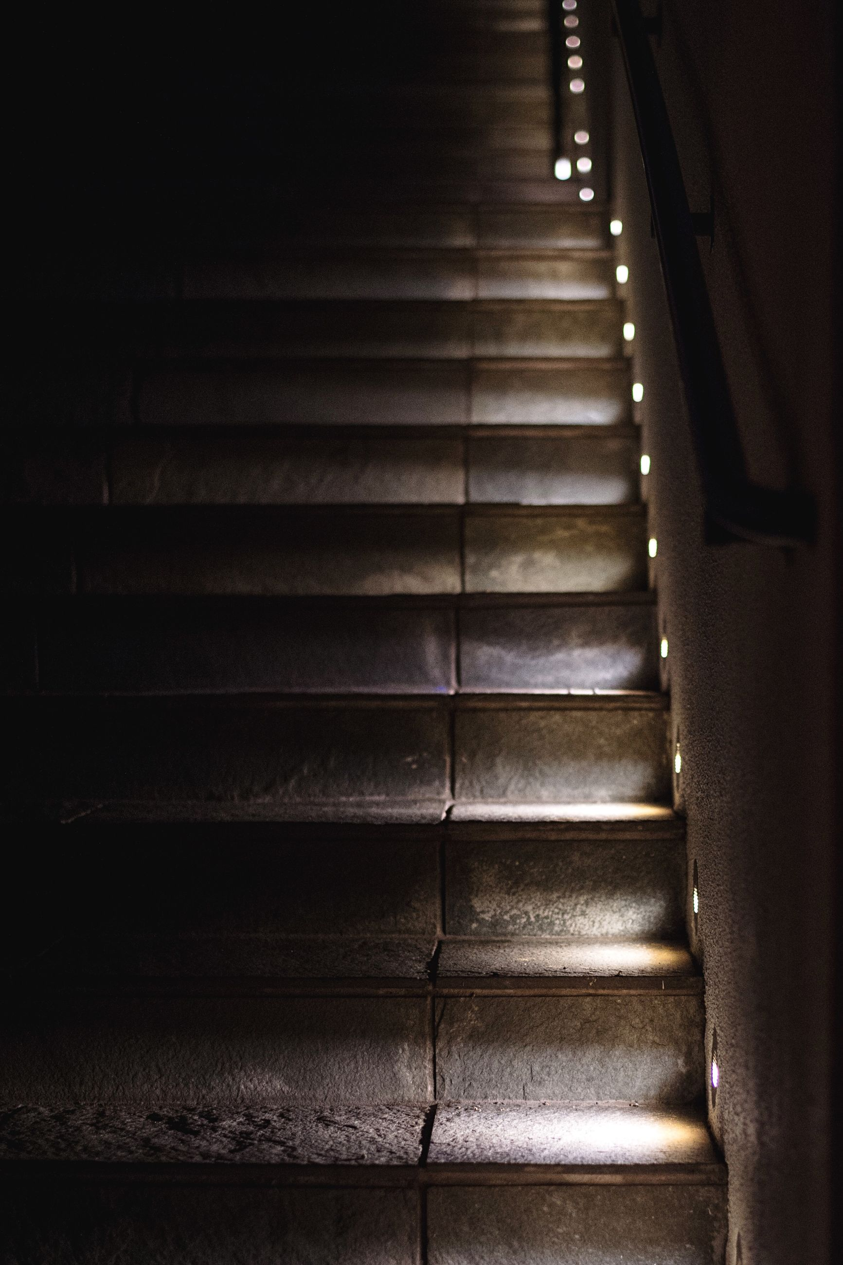 steps, indoors, steps and staircases, staircase, the way forward, pattern, high angle view, diminishing perspective, railing, stairs, no people, wall - building feature, close-up, empty, textured, built structure, sunlight, day, wood - material, auto post production filter