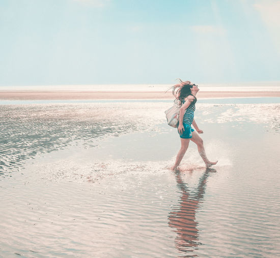 The Portraitist - 2018 EyeEm Awards Beach Beauty In Nature Clothing Females Full Length Horizon Horizon Over Water Land Leisure Activity Lifestyles Nature One Person Outdoors Real People Sand Sea Side View Sky Water Women