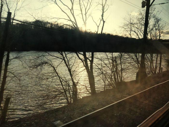 Riversidehouse Eveninglight Traintrackinsnow Sunlightreflection TrainTravelByTheRiver