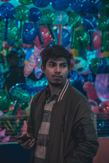 Man Standing Against Toys At Market