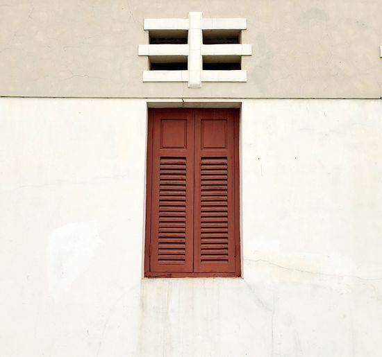 Closed Wooden Window Of Building