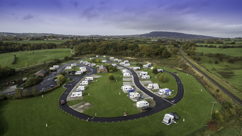 Adventure Aerial View Beauty In Nature Caravan Park Cloud - Sky Countryside Day Field Grass Green Green Color High Angle View Landscape Nature Railway Road Scenics Sky Tranquil Scene Tranquility Transportation Travel Destinations