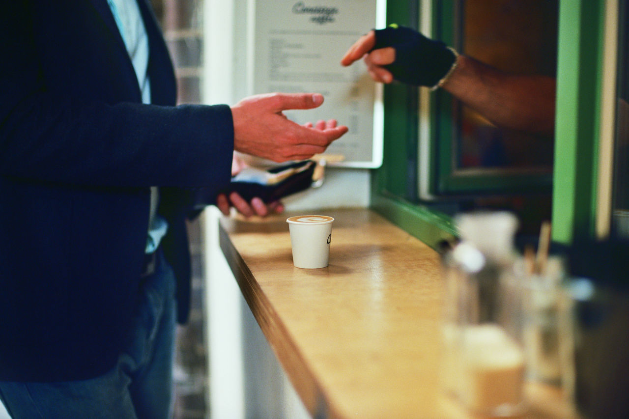 Side view of one man purchasing a coffee