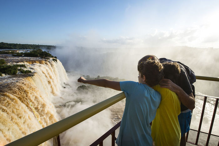 Iguazu waterfalls, view from Brazil side Amazonas Brazil This Is Latin America Beauty In Nature Family Time Iguazu Falls Leisure Activity Looking At View Nature Outdoors People Positive Emotion Real People Rear View Scenics - Nature Togetherness Vacation Water Waterfall Waterfalls My Best Travel Photo
