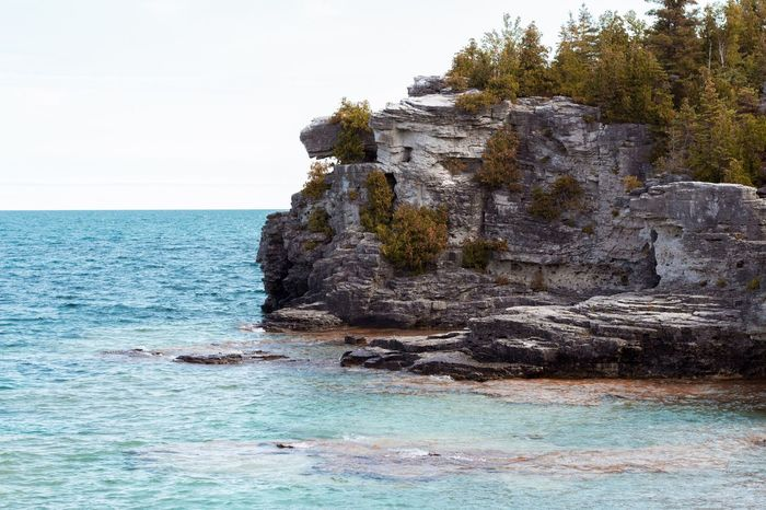 Sea Water Rock - Object Nature Beauty In Nature Rock Formation Tranquility Tranquil Scene No People Waterfront Outdoors Horizon Over Water Day Cliff Sky Clear Sky Tree