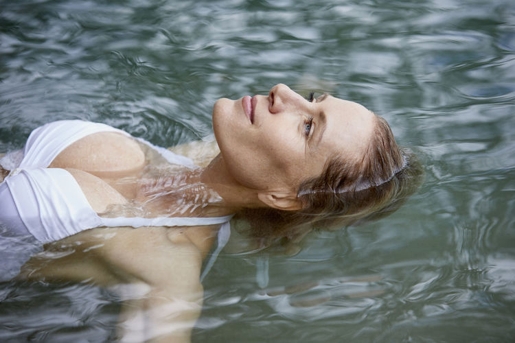 High angle view of woman relaxing in lake