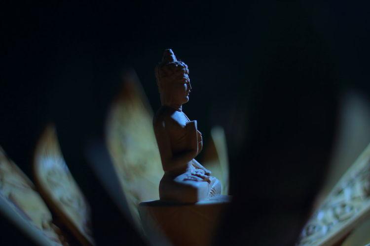 Close-up of buddha figurine