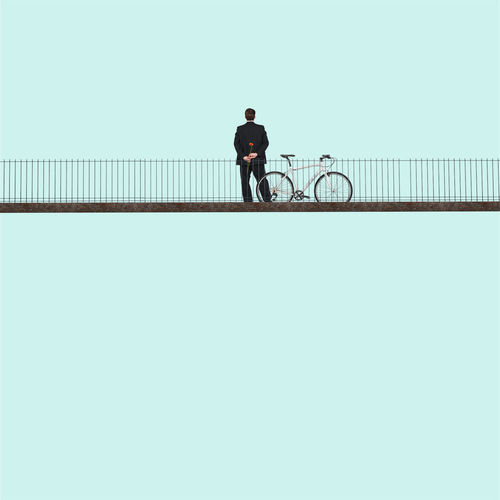 Man With Bicycle On Railing In City