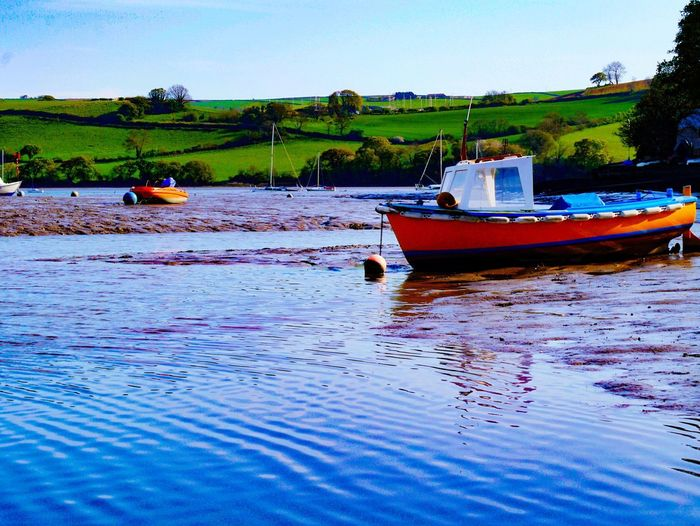 Low tide at Stoke Gabriel Nautical Vessel Water Transportation Nature Moored Tranquility Mode Of Transport Scenics Outdoors Beauty In Nature Tranquil Scene Reflection Waterfront Day River No People Devon EyeEmNewHere Low Tide Stoke Gabriel Landscape Sky Clear Sky