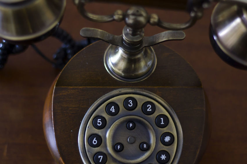 Vintage phone on wooden table. Top View Antiquated Antique Classic Retro Call Close-up Communication Connection Device Dial Dial Phone Handset High Angle View Landline Phone Number Old Old Telephone Phone Retro Styled Style Technology Telecommunications Equipment Telephone Vintage Wood - Material
