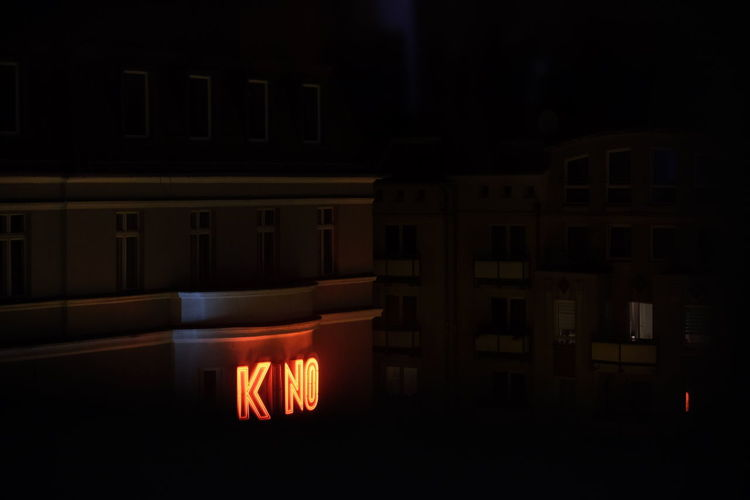 Architecture Arts Culture And Entertainment Cinema City Communication Dark Glowing Illuminated Indoors  Kino Light Light - Natural Phenomenon Lighting Equipment Night No People Orange Color Red Reflection Religion Sign Text