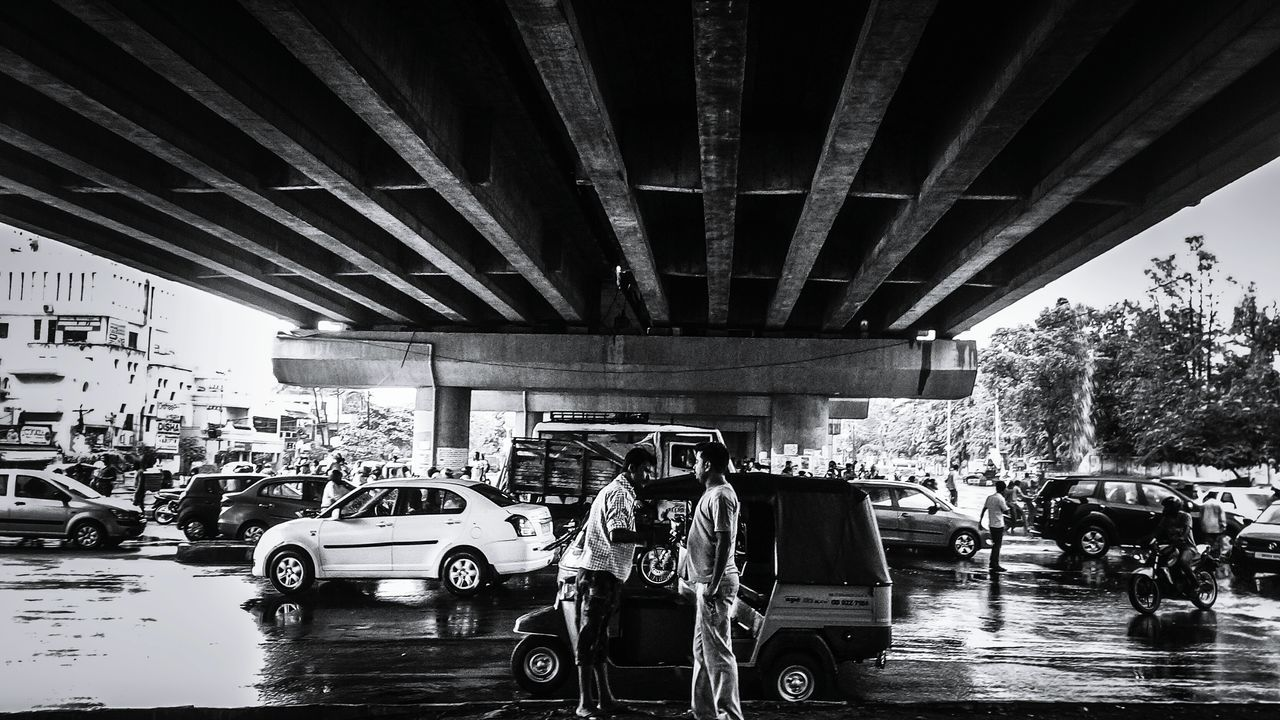 bridge - man made structure, transportation, car, connection, land vehicle, architecture, below, built structure, real people, mode of transport, under, road, day, outdoors, men, city, people