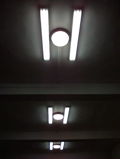 Low angle view of illuminated light on ceiling