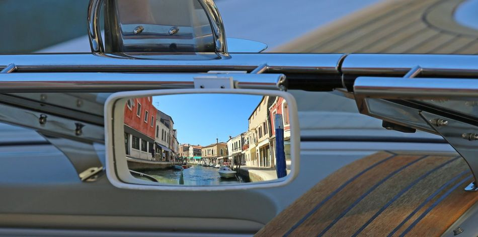 rearview mirror of the boat in the canal of an island Harbor Mirror Mirrored Murano Rear View Rearview Rearview Mirror Taxi Transport Transportation Boa Boat Boats Burano Mirror Reflection Moored Nautical Vessel Rear View Mirror Rearviewmirror Sailing Ship Venice Vessel Yacht Yachting