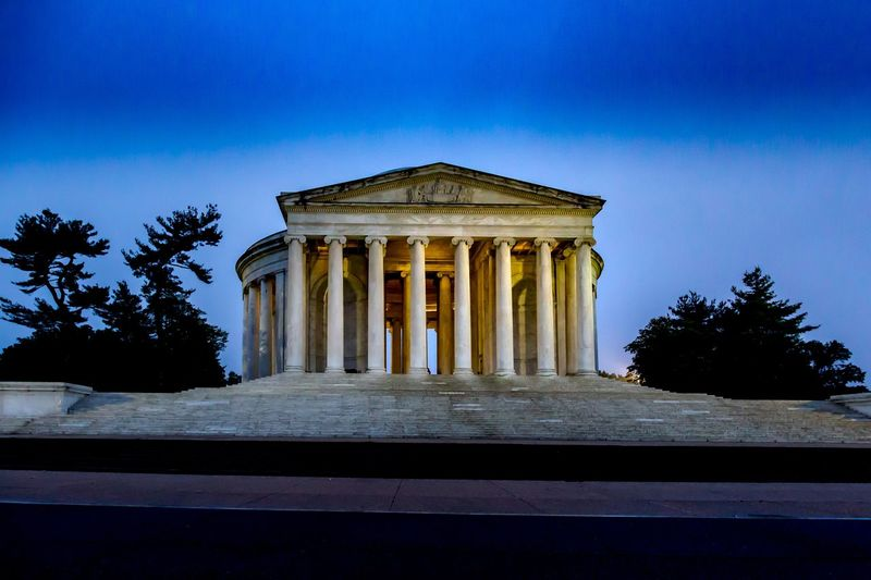Thomas Jefferson Memorial Thomas Jefferson Memorial Memorial Architecture Sky Tree Built Structure Architectural Column Plant The Past History Travel Destinations Building Exterior Nature Blue No People Memorial Low Angle View City Outdoors Monument Day Colonnade