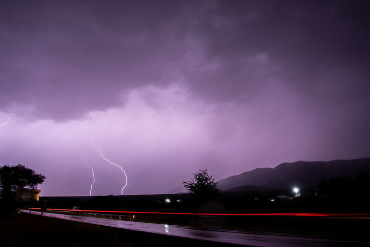 Lightning Storm Power In Nature Cloud - Sky Sky Power Thunderstorm Night Beauty In Nature Storm Cloud Nature Sign No People Purple Illuminated Forked Lightning Road Warning Sign Outdoors Ominous My Best Photo Streetwise Photography