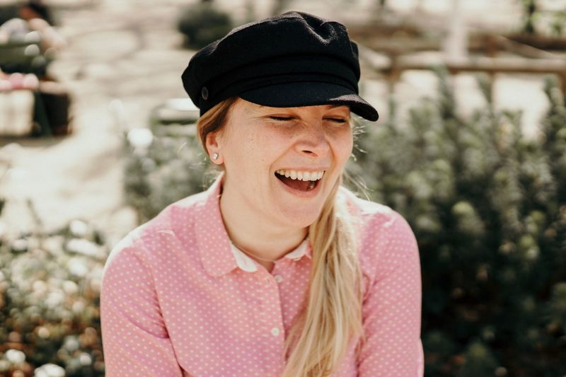 Close-up of smiling woman wearing cap