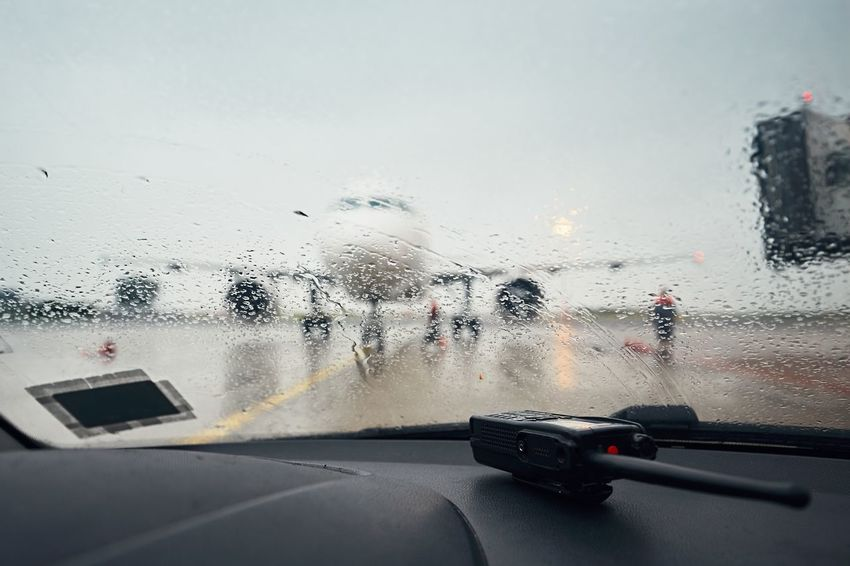 A busy airport in the rain. A view through a wet window on the airplane before flight. Delay Gate Plane Rain Storm Transportation Travel Traveling Weather Aerospace Industry Aircraft Airplane Airport Airport Waiting Airportphotography Aviation Aviationphotography Drop Glass - Material Gloomy Journey RainDrop Water Wet Window