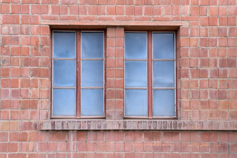 Full frame shot of window on brick wall