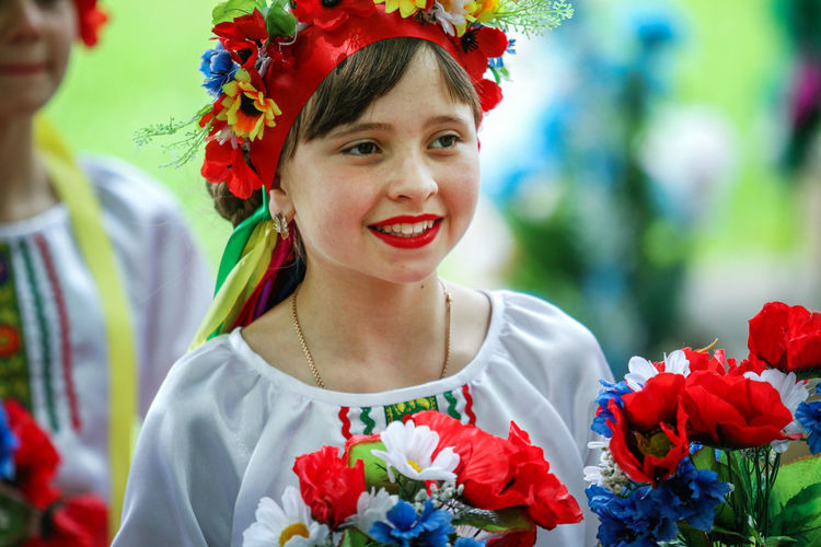Transcarpathian Region Beautiful Woman Bouquet Bride Celebration Day Flower Flower Shop Folklore Fragility Freshness Front View Gift Happiness Holding Multi Colored One Person Outdoors Portrait Real People Smiling Standing Wearing Flowers Young Adult Young Women