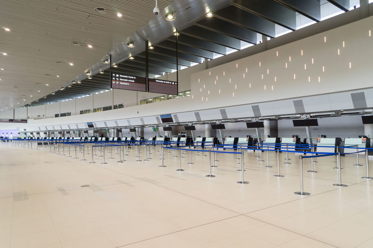 Adult Airport Airport Departure Area Airport Terminal Architecture Built Structure Ceiling Crowd Flooring Group Of People Illuminated In A Row Indoors  Large Group Of People Lifestyles Men Modern Real People Tiled Floor Travel Waiting Women