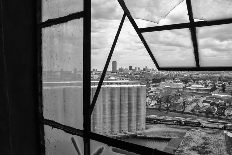 Abandoned grain silo mill Bradleywarren Photography Bradley Olson Backgrounds Background No People Room For Text Copy Space Copyspace The Way Forward Old Old-fashioned Old Ruin Old Buildings Abandoned Abandoned Places Abandoned Buildings Abandoned & Derelict Vintage Retro Architecture Built Structure Cityscape Building Exterior Sky Window City Cloud - Sky Day Transparent Building Nature Outdoors Glass - Material High Angle View Financial District