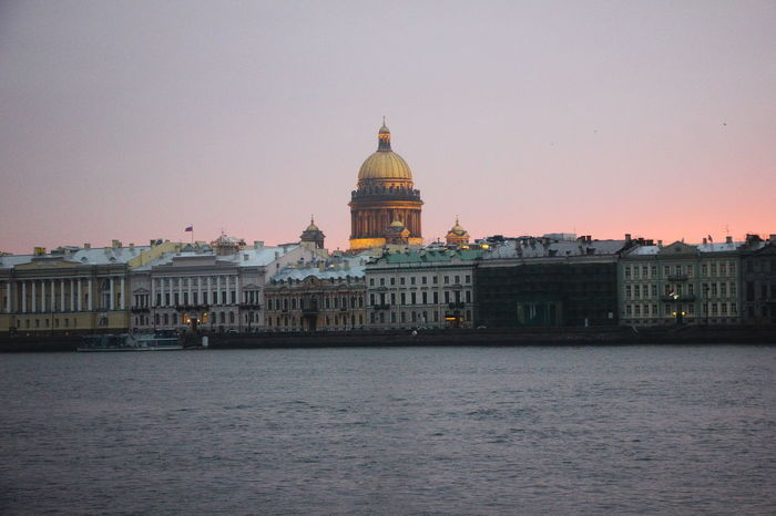The view of Saint Petersburg's embankment of Neva River with the row classic buildings and the gilded dome Saint Isaac Cathedral. Russia Saint Isaac's Cathedral Saint Petersburg, Russia. Saint-Petersburg Architecture Dome Neva River Russian Travel Travel Destinations Waterfront