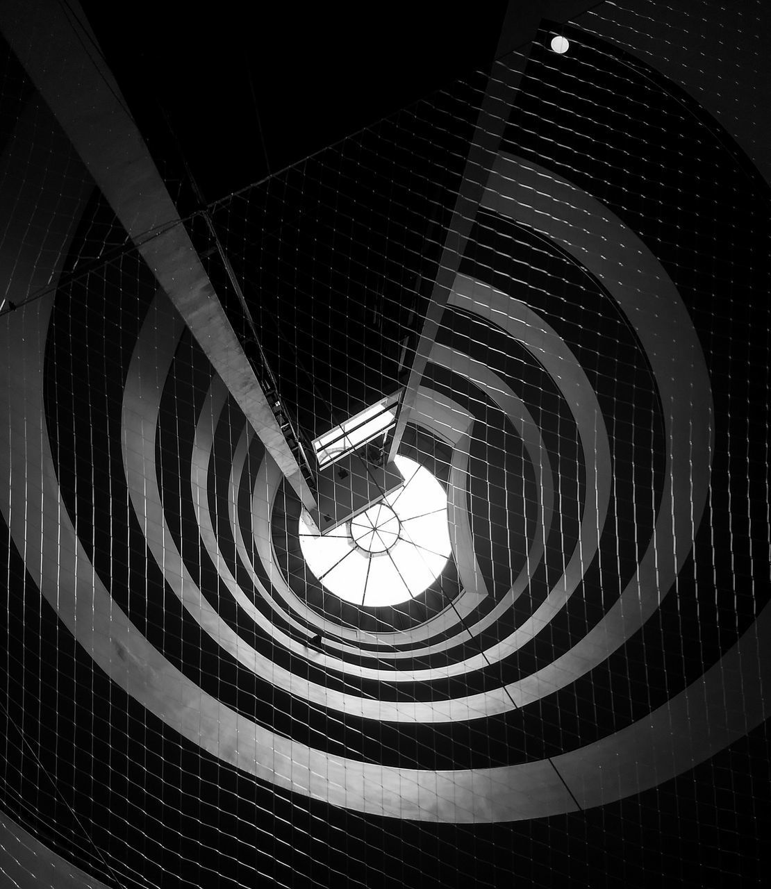 built structure, architecture, indoors, pattern, modern, staircase, steps and staircases, low angle view, shape, spiral, design, geometric shape, ceiling, building, architectural feature, railing, illuminated, circle, no people, skylight, directly below, digital composite