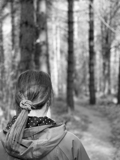 Rear view of woman in forest