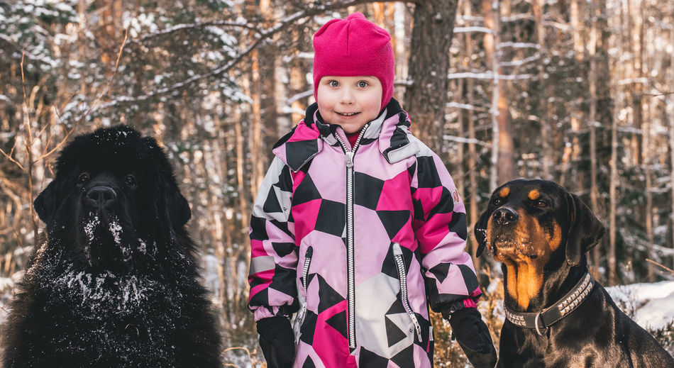 Dog Child Cold Temperature Winter Children Only Warm Clothing Pets Childhood Outdoors Animal People Front View Cute Snow
