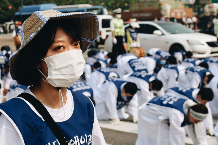 SEOUL, KOREA - APRIL 30, 2018 : Assembly of a group of free demonstrators at the area of Gwanghwamun Square. Candid Candid Photography Editorial Use Only Editorial Shoot Editorial Photo Editorial  Editorial Photography Editorialphotographer Asianstreets Marching Demonstration Demonstrators Seoul Korea Autumn Summer Snow Portrait Headshot Close-up Gas Mask Protective Mask - Workwear Surgical Cap