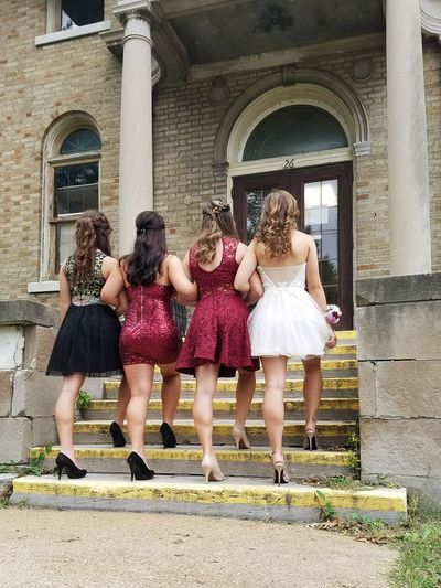 Child Friendship Architecture Building Exterior People Day Outdoors Togetherness Standing Built Structure Full Length Fancy Fancy Dress Glamour Homecoming 2016 Black Red White Dresses Teenagers  Long Hair Rear View Steps Columns Stairs