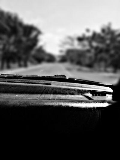 Close-up of car against sky