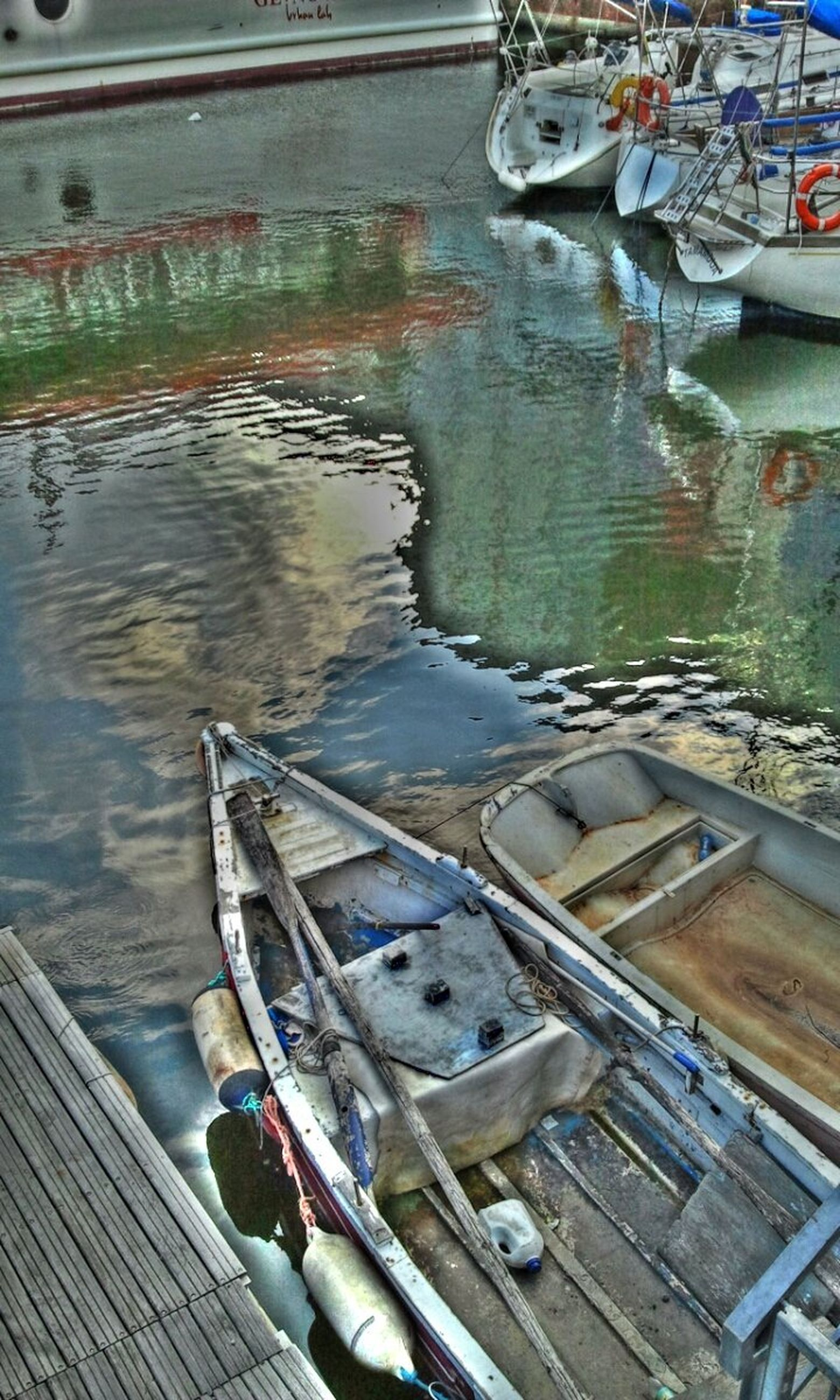 transportation, water, mode of transport, nautical vessel, moored, boat, high angle view, harbor, reflection, canal, river, day, outdoors, no people, lake, travel, land vehicle, pier, built structure, rippled