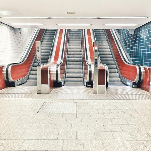 Empty escalators in illuminated railroad station