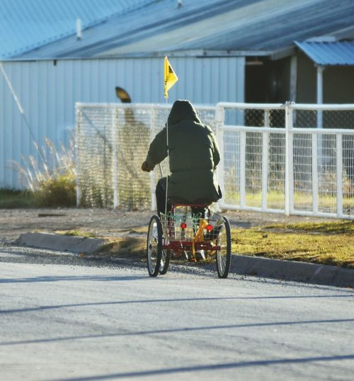 Rear View Of Man On Tricycle