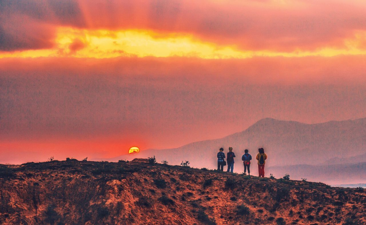 sunset, nature, mountain, orange color, beauty in nature, sky, scenics, landscape, real people, adventure, leisure activity, tranquil scene, cloud - sky, outdoors, hiking, tranquility, mountain range, togetherness, lifestyles, friendship, men, day, people